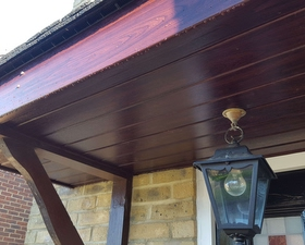 A porch just been done in a rosewood colour